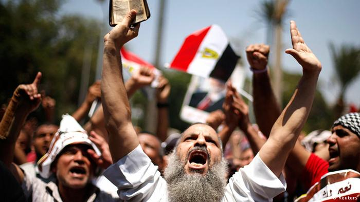 A protester, who supports former Egyptian President Mohamed Mursi, chants slogans during a rally near Cairo University after Friday prayers in Cairo July 5, 2013. Islamist allies of ousted president Mursi called on people to protest on Friday to express outrage at his overthrow by the army and to reject a planned interim government backed by their liberal opponents. REUTERS/Suhaib Salem (EGYPT - Tags: POLITICS CIVIL UNREST TPX IMAGES OF THE DAY)