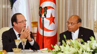 French President Francois Hollande delivers a speech beside Tunisian President Moncef Marzouki (R) before the state dinner at the Carthage Palace in Tunis, July 4, 2013. REUTERS/Anis Mili (TUNISIA - Tags: POLITICS)
