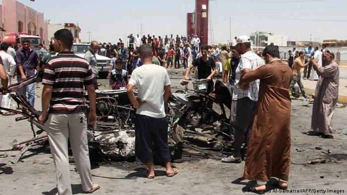 Iraqis inspect the site of a suicide car bomb attack in the Al-Haq square in Samarra, a predominantly Sunni town north of Baghdad, on July 5, 2013. Attacks killed five people in town squares in Iraq, including four who died when a suicide bomber set off his vehicle rigged with explosives just before midday prayers. AFP PHOTO/MAHMOUD AL-SAMARRAI (Photo credit should read MAHMOUD AL-SAMARRAI/AFP/Getty Images)