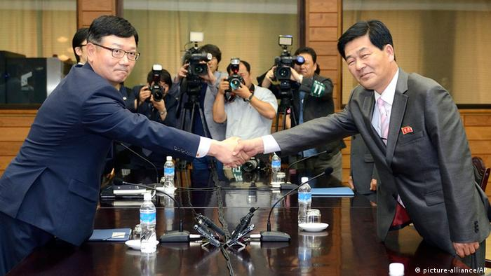 Suh Ho, the head of South Korea's working-level delegation, left, shakes hands with his North Korean counterpart Park Chol Su during their meeting at Tongilgak in North Korean side of Panmunjom which has separated the two Koreas since the Korean War, Saturday, July 6, 2013. Delegates from North and South Korea began talks Saturday on restarting a stalled joint factory park that had been a symbol of cooperation between the bitter rivals. (AP Photo/Korea Pool via Yonhap) KOREA OUT pixel