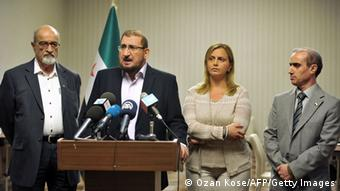 Members of Syrian National Coalition (SNC) Haitham Maleh (L) , Abdul al Karim Bakkar (2ndL) Farah al Atassi (2ndR) and Abdul Rahman Battra (R) give a press conference, on July 4, 2013 in Istanbul, to announce taht Syria's main political opposition will attempt to nominate a new leader to unify a fractured coalition. AFP PHOTO/ OZAN KOSE (Photo credit should read OZAN KOSE/AFP/Getty Images)