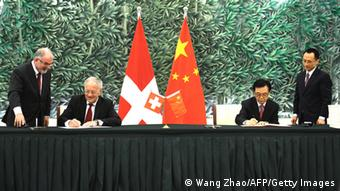 Federal Councillor and Head of the Federal Department of Economic Affairs of Switzerland Johann Schneider-Ammann (2nd L) and Chinese Minister of Commerce Gao Hucheng (2nd R) attend a signing ceremony in Beijing on July 6,2013. China and Switzerland signed a free trade agreement -- Beijing's first with a contintental European country -- in a deal reached against the backdrop of trade tensions between the Asian giant and the European Union. AFP PHOTO / WANG ZHAO (Photo credit should read WANG ZHAO/AFP/Getty Images)