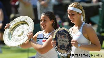 Marion Bartoli of France (L) holds her trophy, the Venus Rosewater Dish, after defeating Sabine Lisicki of Germany (R) in their women's singles final tennis match at the Wimbledon Tennis Championships, in London July 6, 2013. REUTERS/Toby Melville (BRITAIN - Tags: SPORT TENNIS)