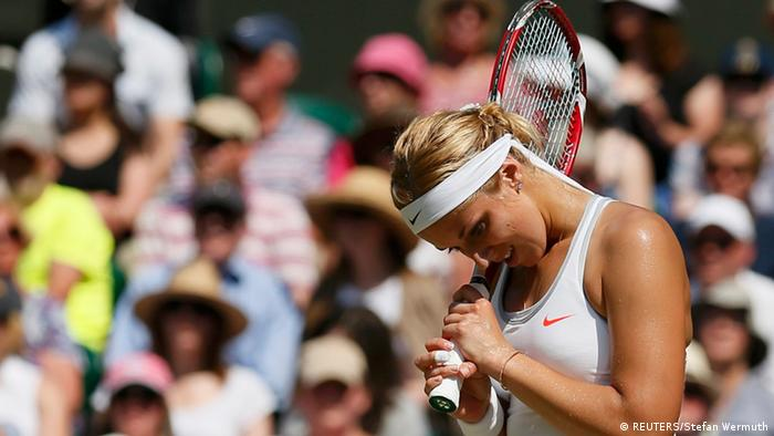 Sabine Lisicki of Germany reacts during her women's singles final tennis match against Marion Bartoli of France at the Wimbledon Tennis Championships, in London July 6, 2013. REUTERS/Stefan Wermuth (BRITAIN - Tags: SPORT TENNIS)