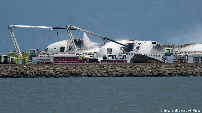 A fire truck sprays water on Asiana Flight 214 after it crashed at San Francisco International Airport (AP Photo/Noah Berger)