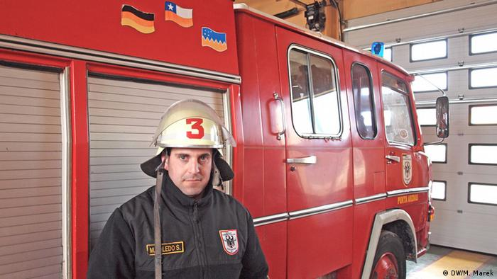 Mario Toledo in front of one of the fire engines. (Photo: Michael Marek)