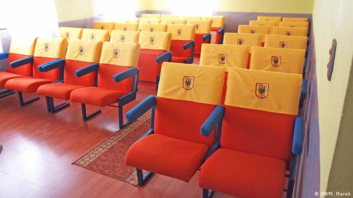 Meeting room at Punta Arenas German volunteer fire brigade with seats that combine national symbols of both countries (Photo: Michael Marek)
