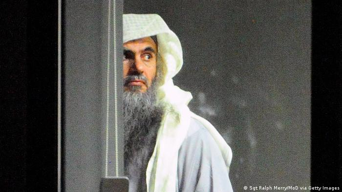 LONDON, ENGLAND - JULY 7: (NO SALES) (EDITORIAL USE ONLY) In this handout image provided by the MoD, radical cleric Abu Qatada (L) prepares to board a plane at RAF Northolt which will take him to Jordan, after he was deported from the UK to face terrorism charges in his home country, on July 7, 2013 in London, England. (Photo by Sgt Ralph Merry/MoD via Getty Images)