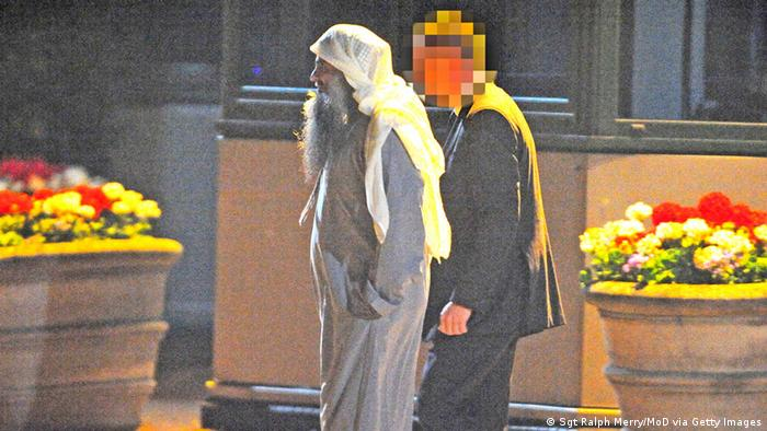 LONDON, ENGLAND - JULY 7: (NO SALES) (EDITORIAL USE ONLY) In this handout image provided by the MoD, radical cleric Abu Qatada boards a plane at RAF Northolt which will take him to Jordan, after he was deported from the UK to face terrorism charges in his home country, on July 7, 2013 in London, England. (Photo by Sgt Ralph Merry/MoD via Getty Images)