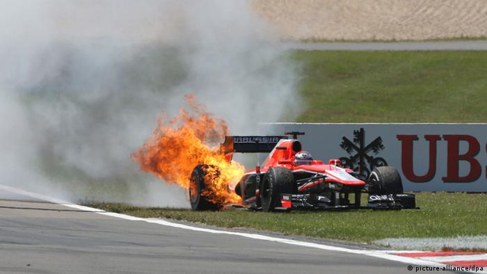 The car of French Formula One driver Jules Bianchi of Marussia catches fire during the Grand Prix of Germany at the Nuerburgring circuit in Nuerburg, Germany, 07 July 2013. Photo: Thomas Frey/dpa