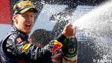 Vettel bei der Siegerehrung am Nürburgring im Juli 2013. Foto: Reuters.