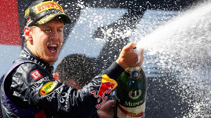 Red Bull Formula One driver Sebastian Vettel of Germany celebrates winning the German F1 Grand Prix at the Nuerburgring circuit, July 7, 2013. REUTERS/Kai Pfaffenbach (GERMANY - Tags: SPORT MOTORSPORT F1 TPX IMAGES OF THE DAY)