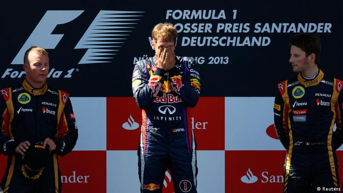Sebastian Vettel celebrates his 2013 German GP win on the podium at the Nürburgring