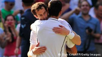 Britain's Andy Murray (back) embraces Serbia's Novak Djokovic after Murray's victory in the men's singles final on day thirteen of the 2013 Wimbledon Championships tennis tournament at the All England Club in Wimbledon, southwest London, on July 7, 2013. Murray won 6-4, 7-5, 6-4. AFP PHOTO / GLYN KIRK - RESTRICTED TO EDITORIAL USE (Photo credit should read GLYN KIRK/AFP/Getty Images)