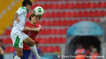 Iraq`s Mohammed Jabbar Shwkan (L) jumps for the ball next to Korea Republic`s defender Yeon Jeimin during the quarter final football match between Iraq and Korea Republic at the FIFA Under 20 World Cup at Kadir Has Stadium in Kayseri on July 7, 2013. AFP PHOTO / OZAN KOSE RESTRICTED TO EDITORIAL USE (Photo credit should read OZAN KOSE/AFP/Getty Images)