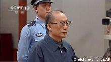 In this image made from China Central Television video, former Chinese Railways Minister Liu Zhijun attends his sentencing at a courtroom at Beijing No. 2 Intermediate People's Court in Beijing Monday, July 8, 2013. The official Xinhua News Agency said Liu was sentenced to death with a two-year reprieve by a court in Beijing on Monday. Such sentences usually are commuted to life in prison with good behavior. Liu, 60, who oversaw the ministry's high-profile bullet train development, was accused of taking massive bribes and steering lucrative projects to associates. Chinese characters at bottom reads Former Railway Minister Liu Zhijun sentencing, Taking bribes and abuse of power sentenced to suspended death sentence. (AP Photo/CCTV via AP Video) CHINA OUT, TV OUT pixel