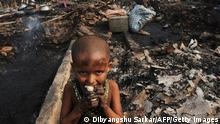 A young child standing in a slum (photo: DIBYANGSHU SARKAR/AFP/Getty Images)