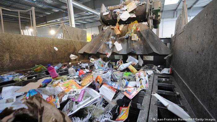 Plastic is put through a machine at a recycling plant in France