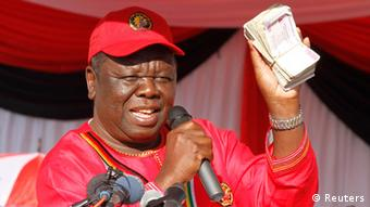 Zimbabwe opposition Movement For Democratic Change (MDC) leader Morgan Tsvangirai speaks at the launch of his party's election campaign in Marondera, about 70 km (43 miles) east of Harare, July 7, 2013. Tsvangirai, launching his third campaign to unseat veteran President Robert Mugabe, said nothing had been achieved to ensure a fairer vote but even God now wanted Mugabe to go. REUTERS/Philimon Bulawayo (ZIMBABWE - Tags: POLITICS ELECTIONS)