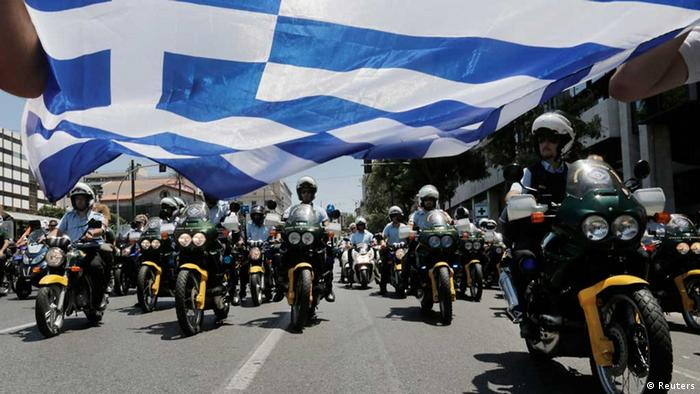 Municipal policemen march on their motorcycles during a rally by local government workers, against the public sector reforms and layoffs Greece has promised its international lenders (Photo: REUTERS/John Kolesidis)