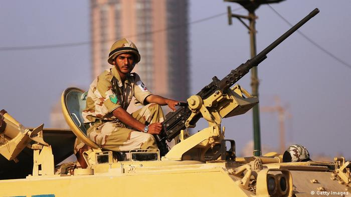 CAIRO, EGYPT - JULY 08: Following a day of massive rallies against the ousted Egyptian President and an early morning shooting of pro Mohamed Morsi supporters outside a Presidential Guard barracks, members of the Egyptian military man an armoured vehicle as they guard a bridge near Tahrir Square on July 8, 2013 in Cairo, Egypt. Egypt continues to be in a state of political paralysis with scores of people having been killed and many injured in recent days as the Egyptian military attempts to restore order across the country following their ousting of Morsi. (Photo by Spencer Platt/Getty Images)