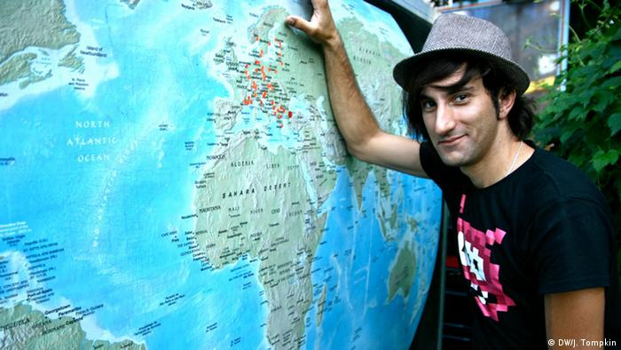 Davide Martello next to the world map on his truck
