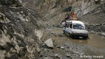 A car drives through a melting glacier on the Karakoram highway on July 6, 2007 in the Upper Hunza Region, Northwest Frontier Province, Pakistan. (Photo: Paula Bronstein /Getty Images)