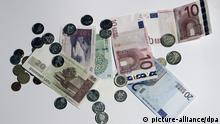 epa03732575 Lats (L) and euro banknotes and coins in Riga, Latvia, 05 June 2013. European Union member states should allow Latvia to join the eurozone on January 1, the bloc's executive said 05 June 2013, after finding that the country fulfilled all conditions. Latvia would, however, 'need to remain vigilant' on inflation, the European Commission warned, calling on the Baltic country to maintain 'a prudent fiscal policy' and keep 'domestic demand on a sustainable path.' Latvia faced massive economic problems in 2008, after its real-estate bubble burst amid the global financial crisis - leading to a 7.5-billion-euro (9.8-billion-dollar) bailout by the EU and the International Monetary Fund. But the country now boasts the EU's highest growth rate, following an austerity-spurred recovery. Its deficit and debt levels are also among the lowest in the EU. The commission said in its latest forecast that it expects Latvia to post a deficit of 1.2 per cent of gross domestic product and debt of 43.2 per cent this year. EPA/VALDA KALNINA LATVIA OUT/LITHUANIA OUT/ESTONIA OUT