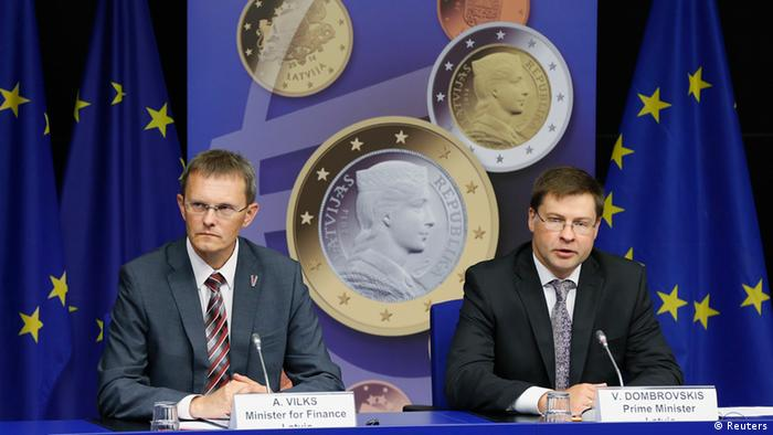 Latvia's Prime Minister Valdis Dombrovskis and Finance Minister Andris Vilks (L) address a news conference on the adoption of the euro by Latvia at the European Union council building in Brussels July 9, 2013. The euro zone embraced tiny Latvia as its newest member on Tuesday, eager to show that the bloc is not disintegrating while doubts remain about southern Europe's ability to overcome more than three years of crisis. REUTERS/Francois Lenoir (BELGIUM - Tags: POLITICS BUSINESS)