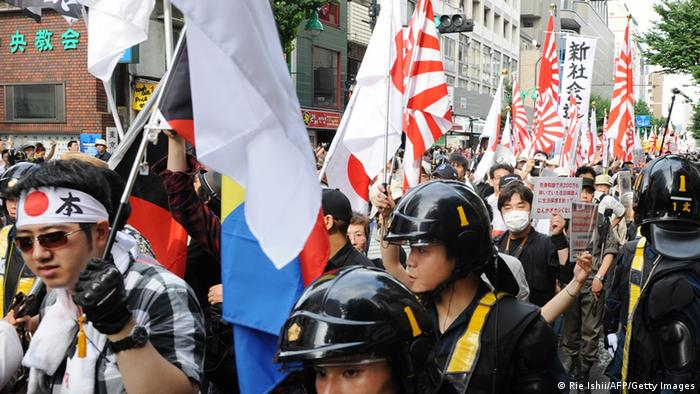 Members of a nationalist group march on the street at Korean Town in Tokyo during a demonstration denouncing South Korean people living in Japan on June 16, 2013. (Photo: AFP)