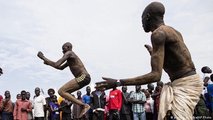 Dinka men covered in mud and cow dung perform a traditional dance at celebrations for South Sudan's second anniversary of independence in Juba, South Sudan, Tuesday, July 9, 2013. After decades of civil war with Sudan, South Sudan became the world's newest country July 9th, 2011 when it gained independence from the north. (AP Photo/Mackenzie Knowles-Coursin)