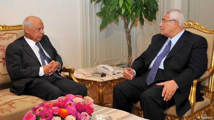 Egypt's interim President Adli Mansour (R) meets with Egypt's former Finance Minister Hazem el-Beblawi at El-Thadiya presidential palace in Cairo July 9, 2013 in this picture provided by the Egyptian Presidency. The interim president on Tuesday named liberal economist el-Beblawi as prime minister in a transitional government, as the authorities sought to steer the country to new parliamentary and presidential elections. REUTERS/Egyptian Presidency/Handout via Reuters (EGYPT - Tags: POLITICS CIVIL UNREST) ATTENTION EDITORS - THIS IMAGE WAS PROVIDED BY A THIRD PARTY. FOR EDITORIAL USE ONLY. NOT FOR SALE FOR MARKETING OR ADVERTISING CAMPAIGNS. THIS PICTURE IS DISTRIBUTED EXACTLY AS RECEIVED BY REUTERS, AS A SERVICE TO CLIENTS. NO SALES. NO ARCHIVES