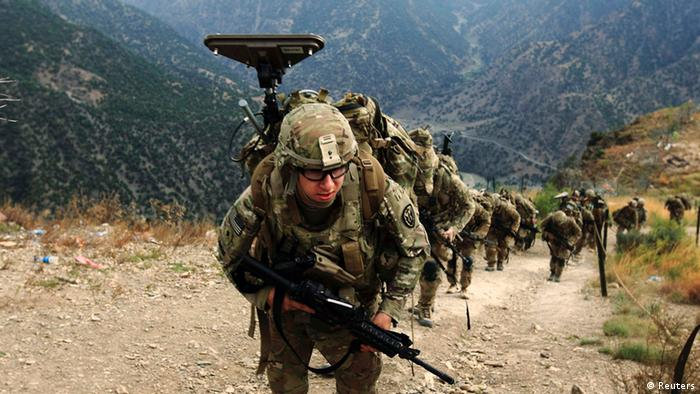 U.S. Army soldiers from Alpha Company 2nd battalion 27th infantry (The Wolfhounds), Task Force No Fear climb upon arrival to Observation Post Mace from Forward Operating Base Bostick in eastern Afghanistan Naray district, Kunar province near border of Pakistan in this August 26, 2011 file photo. The United States is considering pulling out all its troops from Afghanistan next year but is far from making a decision, White House and Pentagon officials said on July 9, 2013 but Afghan officials expressed skepticism that President Barack Obama would back a complete withdrawal. REUTERS/Nikola Solic/Files (AFGHANISTAN - Tags: MILITARY CONFLICT POLITICS)