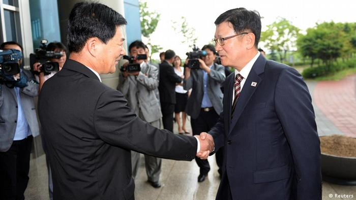 Head of the South Korean working-level delegation Suh Ho (R) shakes hands with his North Korean counterpart Park Chol-su upon Park's arrival at the Kaesong Industrial District Management Committee in Kaesong July 10, 2013. South and North Korea began working-level talks on Wednesday to discuss the normalisation of operations at the jointly run industrial park, including the resumption of facilities inspections, according to local media. REUTERS/Korea Pool/Yonhap (NORTH KOREA - Tags: POLITICS BUSINESS) ATTENTION EDITORS – THIS IMAGE WAS PROVIDED BY A THIRD PARTY. NO SALES. NO ARCHIVES. FOR EDITORIAL USE ONLY. NOT FOR SALE FOR MARKETING OR ADVERTISING CAMPAIGNS. SOUTH KOREA OUT. NO COMMERCIAL OR EDITORIAL SALES IN SOUTH KOREA. THIS PICTURE IS DISTRIBUTED EXACTLY AS RECEIVED BY REUTERS, AS A SERVICE TO CLIENTS