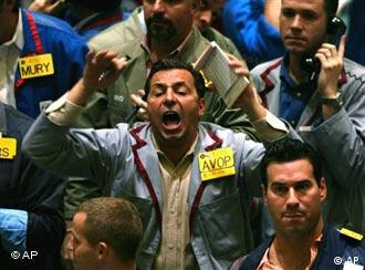 Traders yelling ion the floor of the New York Stock Exchange