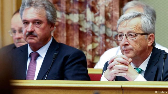 Doi demnitari luxemburghezi: Jean Claude Juncker, preşedintele CE şi ministrul de externe Jean Asselborn, în 2013