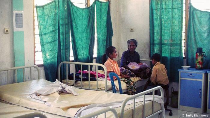 A family in a medical clinic in East Timor