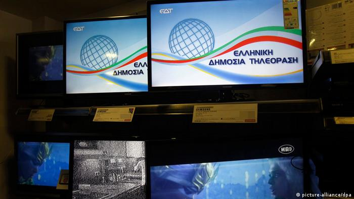 The logo of the Greek Public Television (EDT) is seen on television monitors, transmitted on the old ERT frequencies, on 10 July 2013. According to reports, the program of the transitional channel called Greek Public Television (EDT) that began transmitting its logo on the shutdown ERT public broadcaster frequencies on 10 July morning, is expected to be on air within the next few hours. Deputy Minister for Public Radio and Television Pantelis Kapsis said that initially the program will include feature films and documentaries, while the latest news headlines will be viewed in a ticker at the bottom of the television screen. EPA/ORESTIS PANAGIOTOU +++(c) dpa - Bildfunk+++