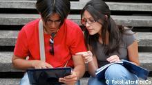 #13784495 - Hispanic couple with a computer © JenKedCo