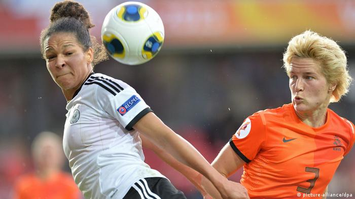 Celia Okoyino da Mbabi (l) of Germany fights for the ball with Daphne Koster of the Netherlands during the UEFA Women's EURO 2013 Group B soccer match between Germany and the Netherlands at the Växjö Arena in Vaxjo, Sweden, 11 July 2013. Photo: Carmen Jaspersen/dpa +++(c) dpa - Bildfunk+++