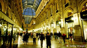 Pompous and illuminated shopping mall Vittorio Emanuele in Milan, Italy.