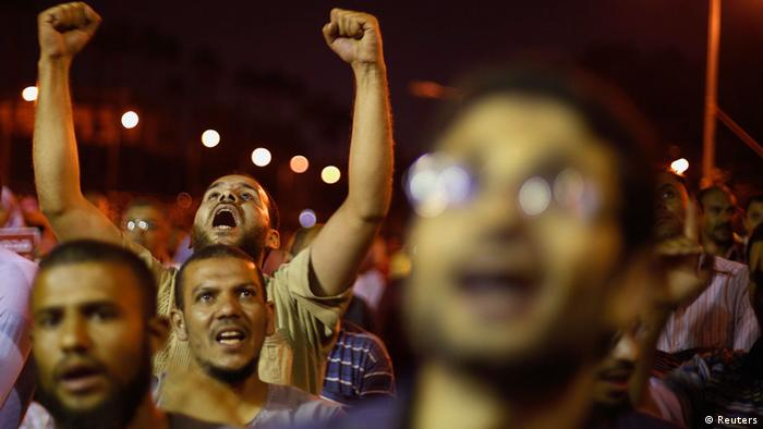Supporters of the deposed Egyptian President Mohamed Mursi shout anti-army slogans during a sit-in protest in Cairo July 11, 2013. U.N. Secretary-General Ban Ki-moon expressed concern on Thursday about continued detentions in Egypt and arrest warrants issued for Muslim Brotherhood leaders and others after the military removed the country's first freely elected leader last week. REUTERS/Suhaib Salem (EGYPT - Tags: POLITICS CIVIL UNREST)