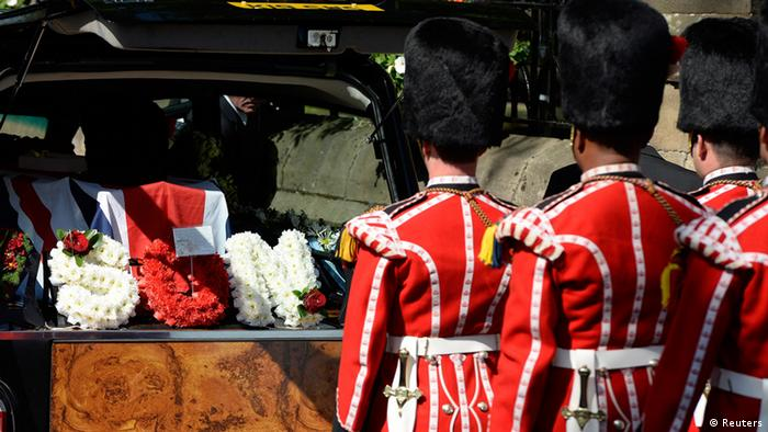 The coffin of Fusilier Lee Rigby arrives for a vigil at Bury Parish Church in Bury, northern England July 11, 2013. The body of Fusilier Lee Rigby, who was fatally stabbed in May on a street in Woolwich, south-east London, arrived at his regiment's garrison church, on Thursday. REUTERS/Nigel Roddis (BRITAIN - Tags: CRIME LAW MILITARY SOCIETY OBITUARY)