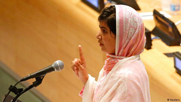 Malala Yousafzai, gives her first speech since the Taliban in Pakistan tried to kill her for advocating education for girls, at the United Nations Headquarters in New York, July 12, 2013. Wearing a pink head scarf, Yousafzai told U.N. Secretary-General Ban Ki-moon and nearly 1,000 students from around the world attending a Youth Assembly at U.N. headquarters in New York that education was the only way to improve lives. REUTERS/Brendan McDermid (UNITED STATES - Tags: POLITICS CRIME LAW EDUCATION TPX IMAGES OF THE DAY)