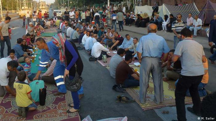 demonstrators breaking their fast in Cairo