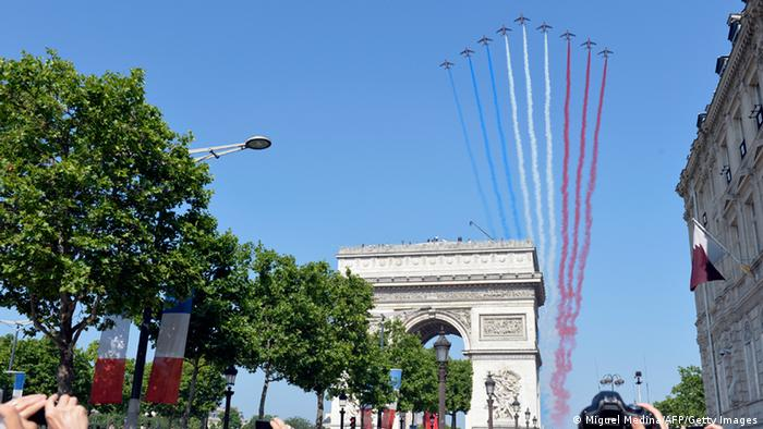 Nine alphajets from the French Air Force Patrouille de France releasing trails of red, white and blue smoke, colors of French national flag, fly over the Arc de Triomphe during the Bastille Day parade on the Champs Elysees avenue, on July 14, 2013 in Paris. AFP PHOTO / MIGUEL MEDINA (Photo credit should read MIGUEL MEDINA/AFP/Getty Images)