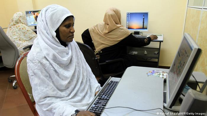 GettyImages 107569405 Sudanese women browse the internet at an office in Khartoum on December 14, 2010 as the authorities arrested about 30 women who tried to hold a protest in the Sudanese capital against the brutal police whipping of a young woman as seen in a video posted on YouTube. AFP PHOTO/ASHRAF SHAZLY (Photo credit should read ASHRAF SHAZLY/AFP/Getty Images)