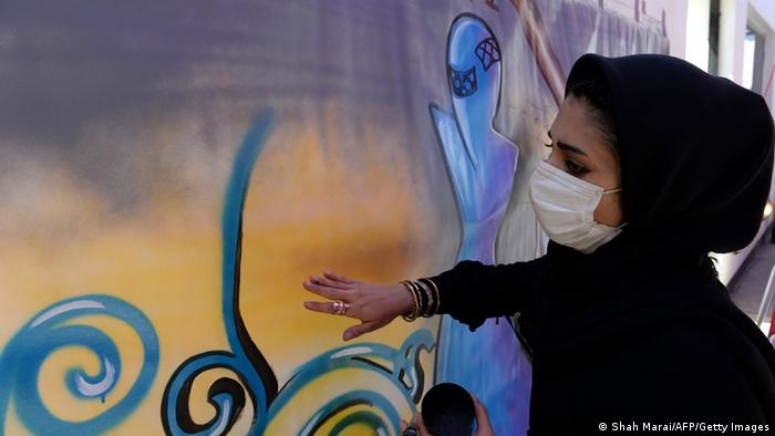 Shamsia Hassani, 25, paints graffiti at the French Cultural Center in Kabul