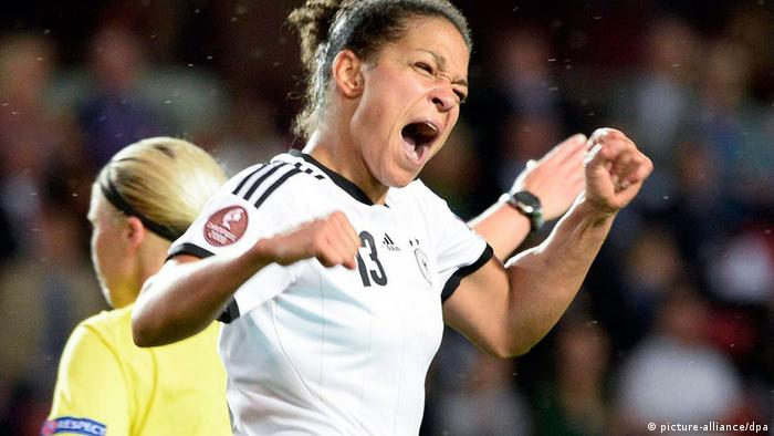 epa03788308 Germany's Celia Okoyino da Mbabi celebrates after scoring her team's second goal during the UEFA Women's EURO 2013 group B soccer match between Iceland and Germany in Vaxjo, Sweden, on July 14, 2013. EPA/MIKAEL FRITZON SWEDEN OUT +++(c) dpa - Bildfunk+++