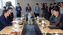 Kim Kiwoong, left, the head of South Korea's working-level delegation, and his North Korean counterpart Park Chol Su, right, attend their meeting at Kaesong Industrial District Management Committee in Kaesong, North Korea, Monday, July 15, 2013. Officials from the two Koreas are meeting for the third time this month to discuss how to restart a stalled inter-Korean factory park which was a key symbol of cooperation between the countries. (AP Photo/Korea Pool via Yonhap) KOREA OUT